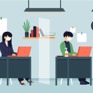 Deux personnes sont assises à leur bureau